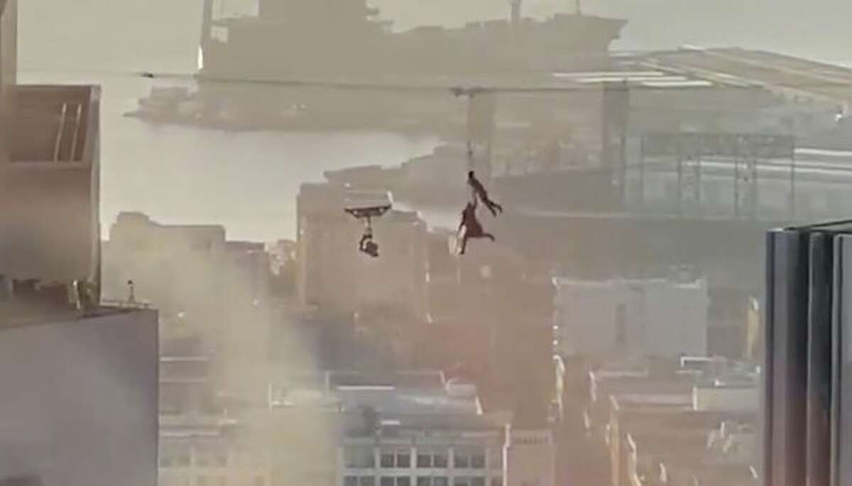 Two people were seen shooting a Matrix 4 scene high up between buildings in downtown San Francisco on Thursday, February 27, 2020.
