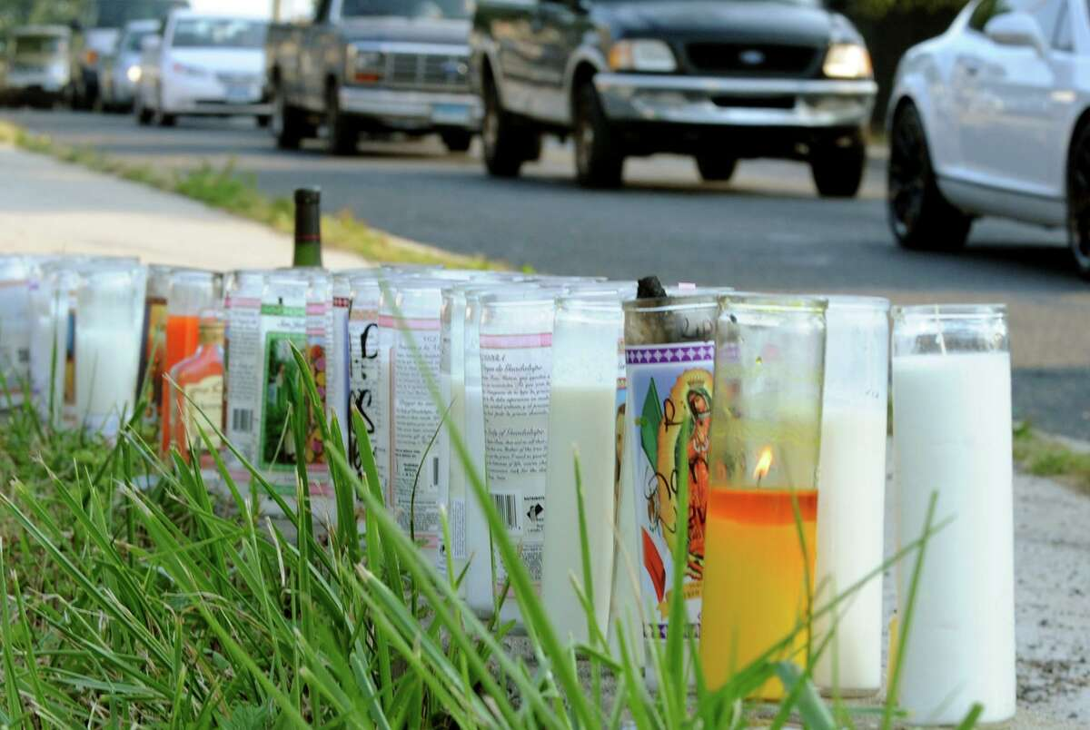 A memorial was set up for shooting victim Christopher Pettway, who died in a shooting on Tuesday, at Reservoir and Trumbull Avenues on Wednesday September 11, 2013.