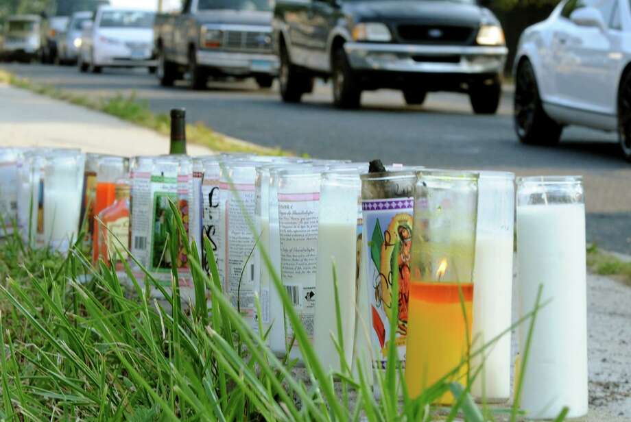 A memorial was set up for shooting victim Christopher Pettway, who died in a shooting on Tuesday, at Reservoir and Trumbull Avenues on Wednesday September 11, 2013. Photo: Christian Abraham / Christian Abraham / Connecticut Post