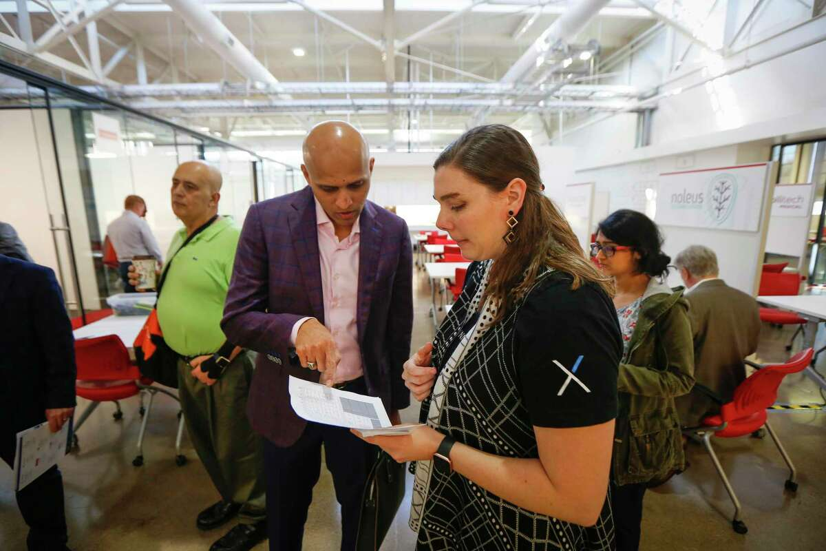 Adviser and sales expert Rohan Bairat talks with Emily Reiser, senior manager of innovation community engagement at the Texas Medical Center, during the TMCx accelerator's new two-week bootcamp Tuesday, Feb. 25, 2020, in Houston.