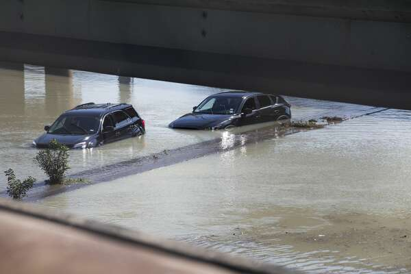 Aabandoned vehicles sit stalled in floodwaters from a water main break that inundated the East Loop 610, closing the major freeway that circles the city on Thursday, Feb. 27, 2020 in Houston.