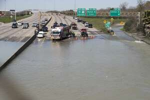 High water from a water main break floods the East Loop 610 on Thursday, Feb. 27, 2020 in Houston. The flooding closed the major freeway that circles the city.