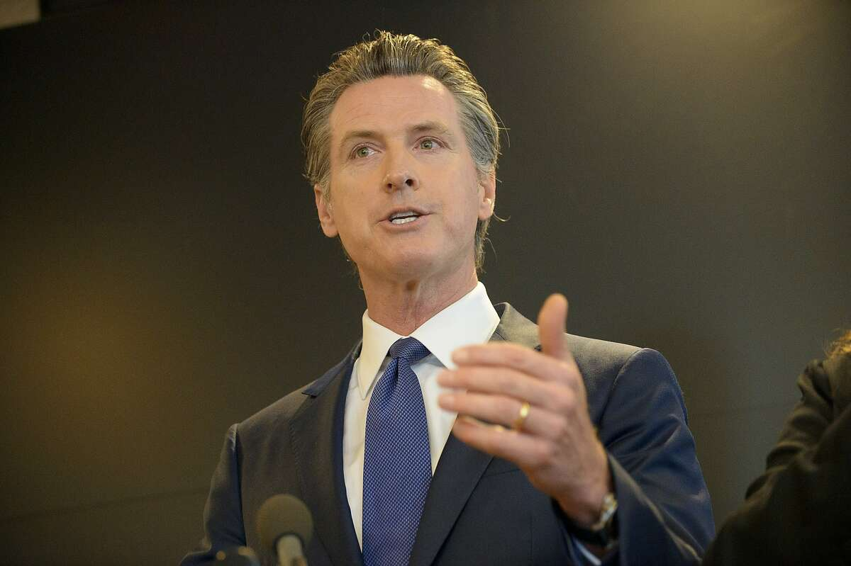 California Governor Gavin Newsom speaks to members of the press at a news conference in Sacramento, Calif., Thursday, Feb. 27, 2020. Newsom spoke about the state's response to novel coronavirus, also known as COVID-19. Yesterday, the Centers for Disease Control and Prevention confirmed a possible first case of person-to-person transmission of COVID-19 in California in the general public.(AP Photo/Randall Benton)