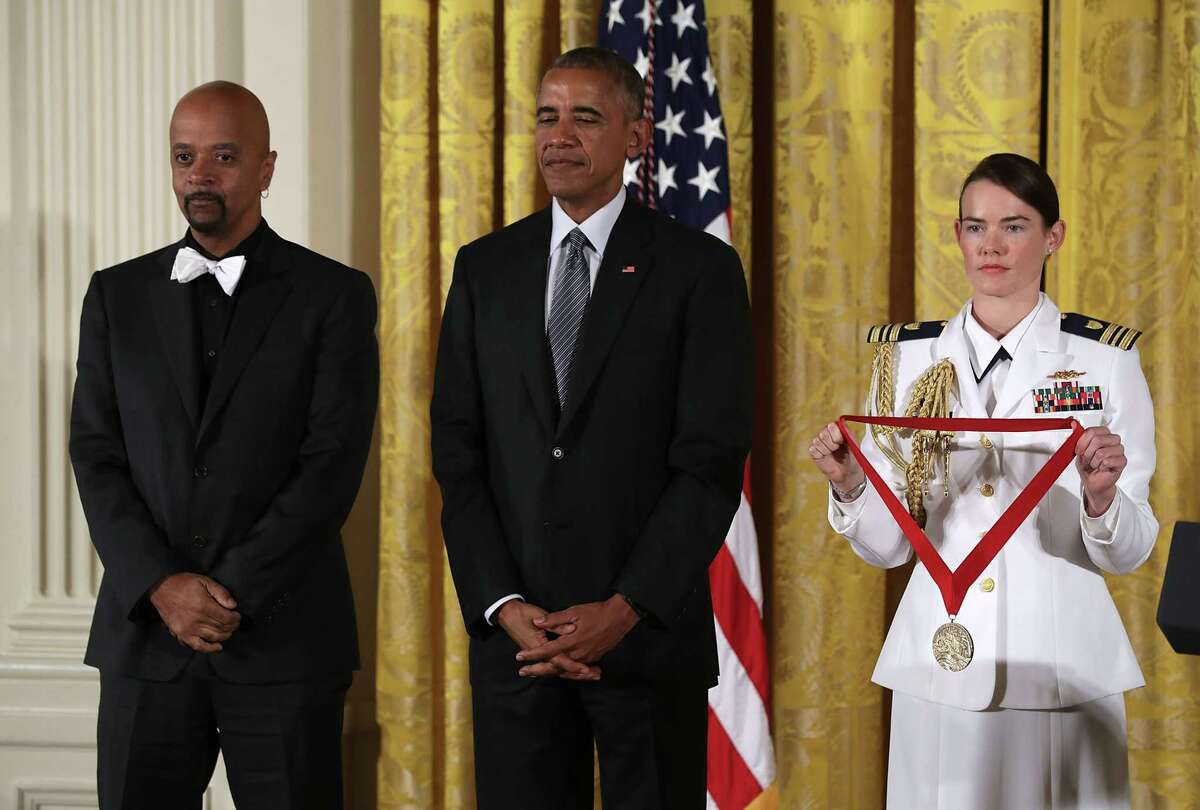 U.S. President Barack Obama (2nd R) presents the National Humanities Medal to author James McBride (L) during an East Room ceremony at the White House September 22, 2016 in Washington, DC. President Obama awarded the 2015 National Medal of Arts and the National Humanities Medal to recipients in the annual ceremony. (Photo by Alex Wong/Getty Images) ORG XMIT: 669749791