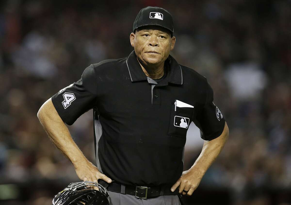 ADDS THE INFORMATION IS FROM ANONYMOUS SOURCE - FILE - In this June 2, 2018, file photo, Major League baseball umpire Kerwin Danley (44) is shown during the first inning of a baseball game between the Arizona Diamondbacks and the Miami Marlins in Phoenix. Major League Baseball has appointed its first African American umpire crew chief, promoting Kerwin Danley to the position this week, The Associated Press has learned. A person familiar with the move spoke to the AP on Wednesday, Feb. 26, 2020 on condition of anonymity because the announcement had not yet been made. (AP Photo/Rick Scuteri, File)