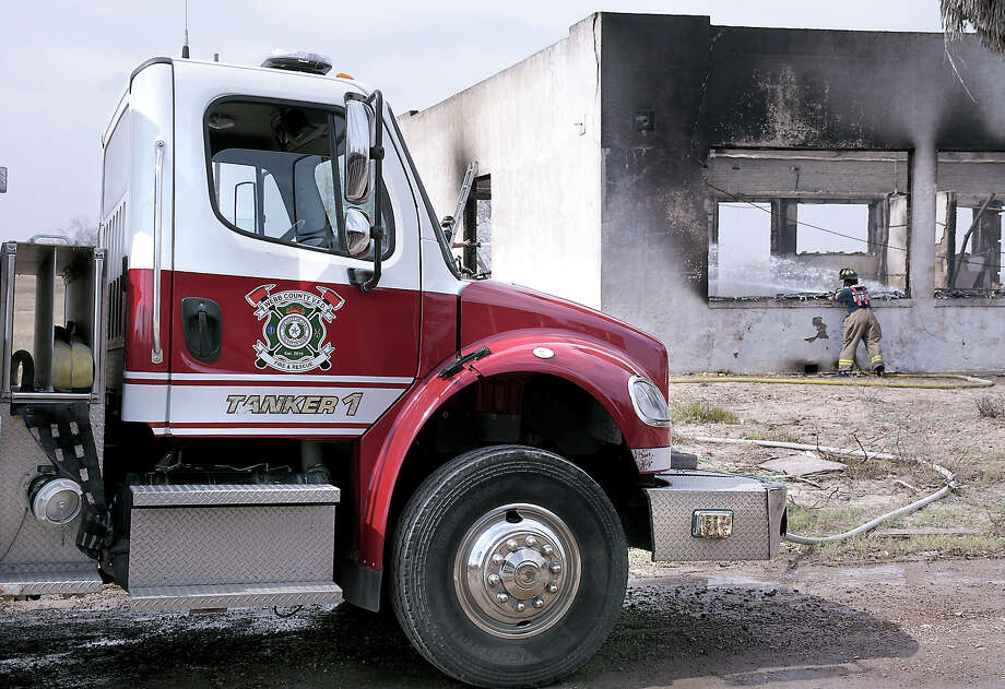 More than 24 hours after a fire started at the old high school in Mirando City, Webb County Volunteer Fire Department personnel were still pumping water to extinguish the blaze Monday, February 10, 2020. Photo: Cuate Santos/Laredo Morning Times