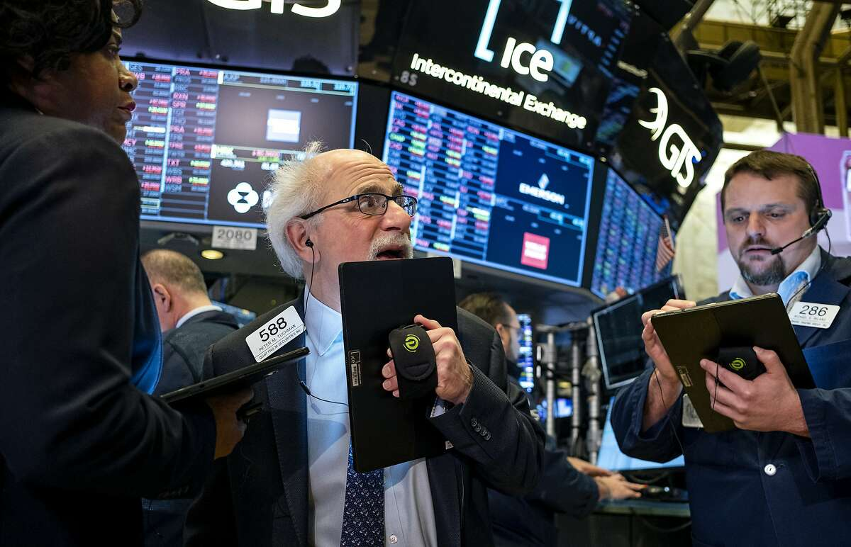 Trader Peter Tuchman works on the floor of the New York Stock Exchange Thursday, Feb. 27, 2020. (AP Photo/Craig Ruttle)