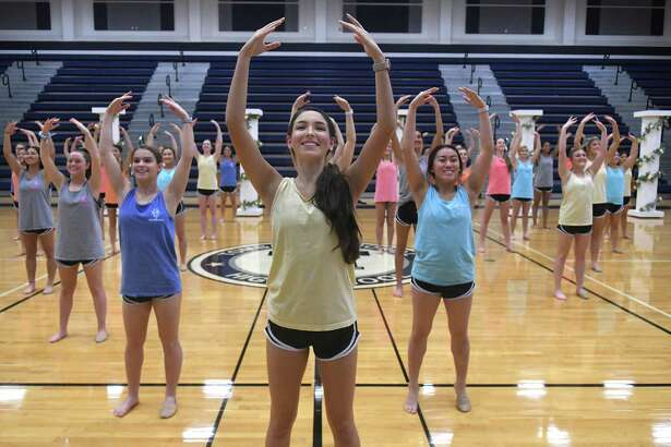 Captain Caroline Valdes, center, leads her Tomball Memorial High School Silver Stars dance team in a rehearsal of their Team Lyrical routine during practice on Feb. 19, 2020, as they prepare for their trip to LA Nationals on March 6-10.
