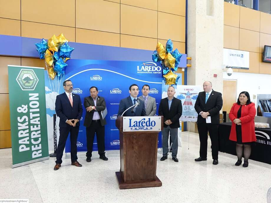 Councilman Roberto Bali speaks in front of city and Laredo International Airport officials Wednesday. The City announced the first-ever Laredo Runway Run 5K and 1K to take place on April 18. The overall male and female winners will win a Mexican Getaway for two through Aeromar Airlines Photo: Courtesy