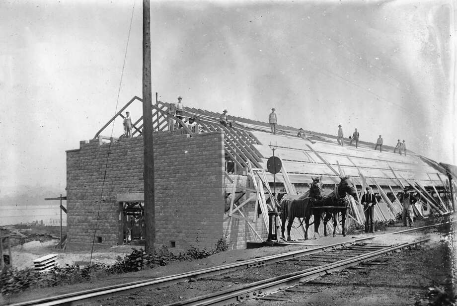 Apple storage shed being built in Elberta by the Berryhill family, later to become the site of the Elberta Packing Co. with the tall smokestack. (Courtesy Photo)