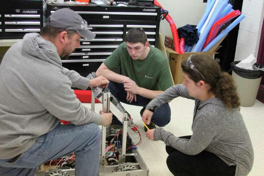 Members of the Brethren High School Robotics team work on their robot to prepare for Saturday's competition in Traverse City. Teams from Brethren, Bear Lake and Manistee Catholic Central will be in action this weekend. (Ken Grabowski/News Advocate)