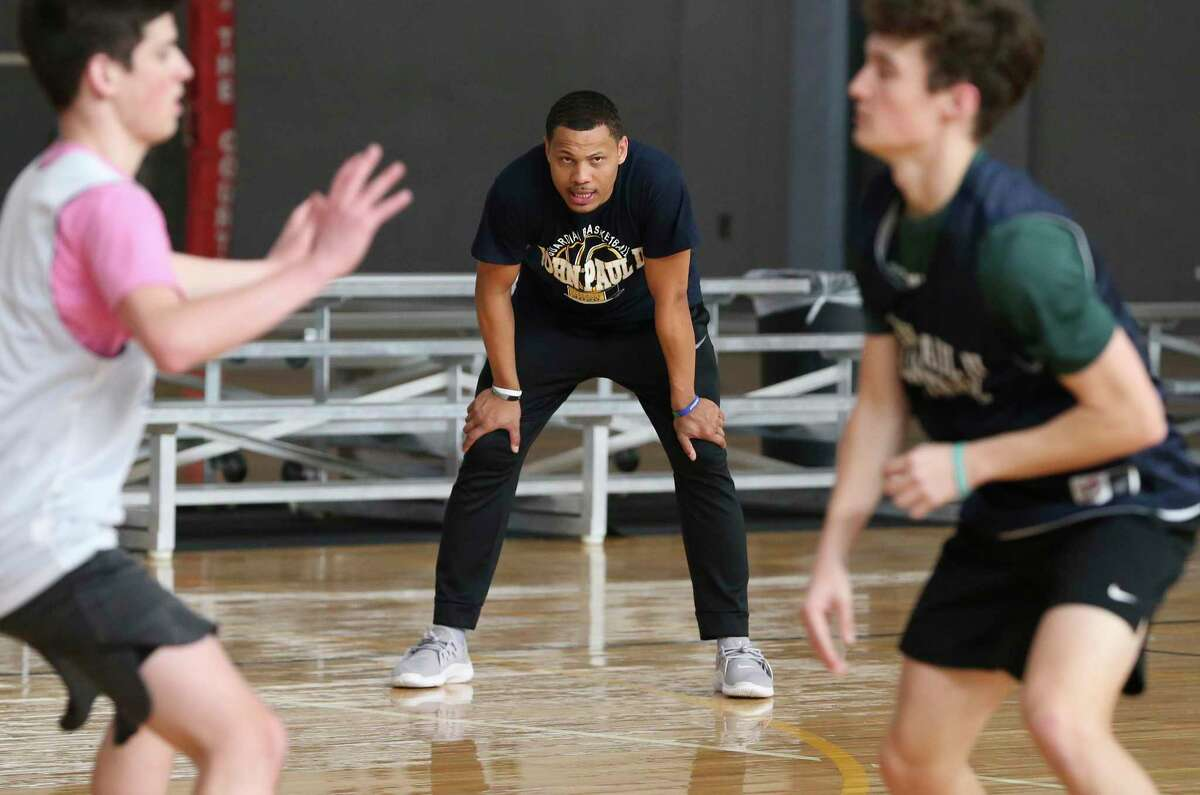 Basketball head coach Forrest Blackwell oversees team practice on Wednesday, Feb. 26, 2020. The St. John Paul II Catholic High School men's basketball team is making its TAPPS state-tournament debut on Friday.