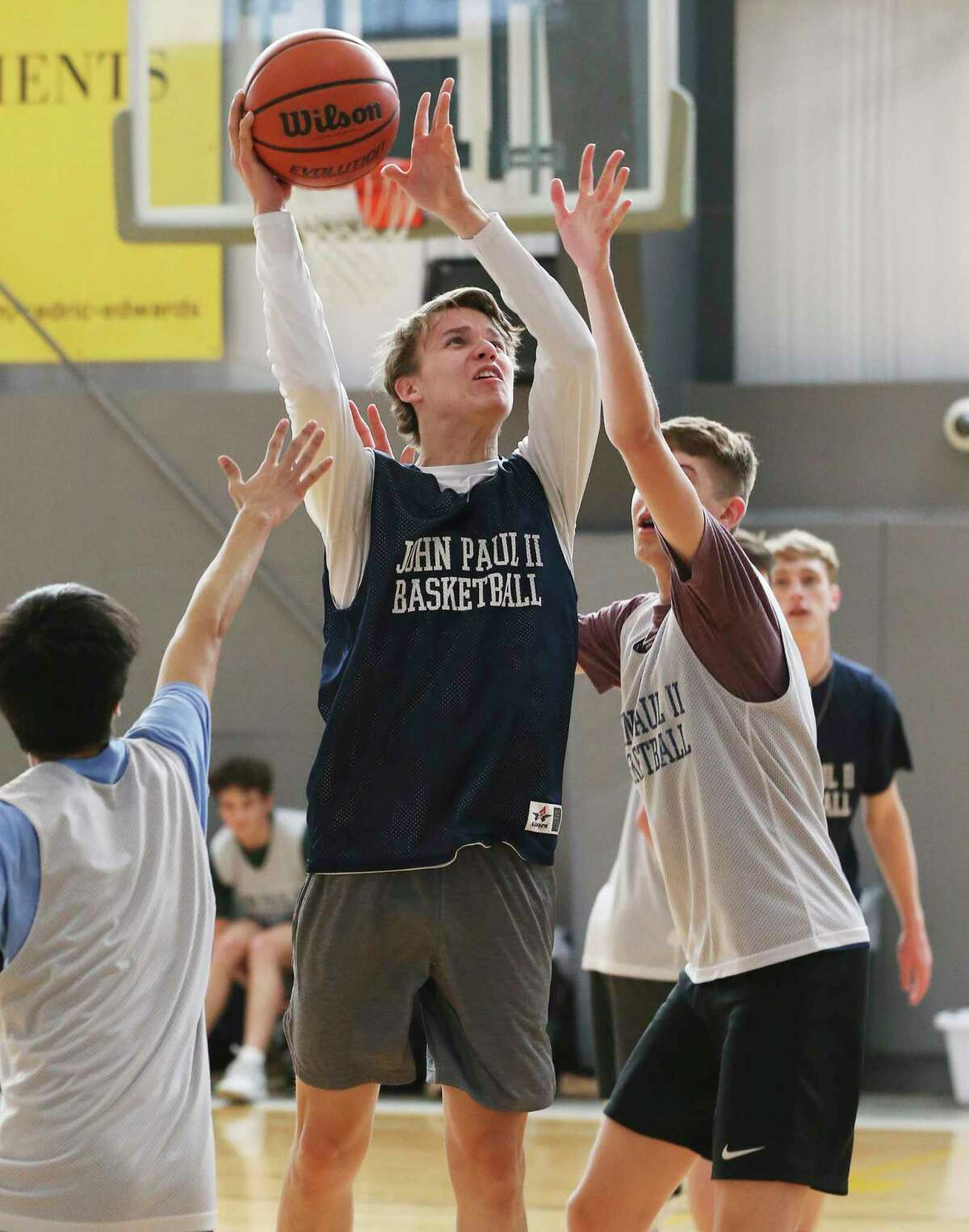 C.J. Kowalik (center) practices with the team on Wednesday, Feb. 26, 2020. The St. John Paul II Catholic High School men's basketball team is making its TAPPS state-tournament debut on Friday.
