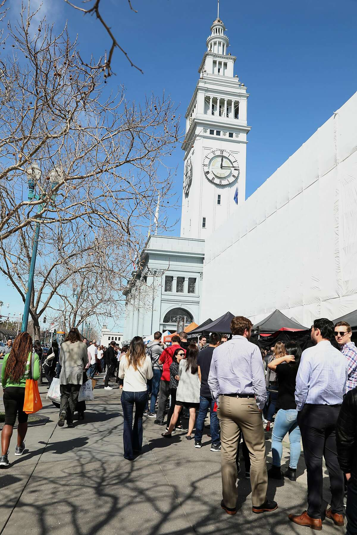 Lunch goers seen in front of the Ferry Building on Thursday, Feb. 27, 2020, in San Francisco, Calif.