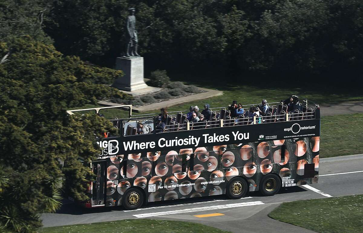 A tour bus drives through Golden Gate Park on Wednesday, Feb. 26, 2020, in San Francisco, Calif.