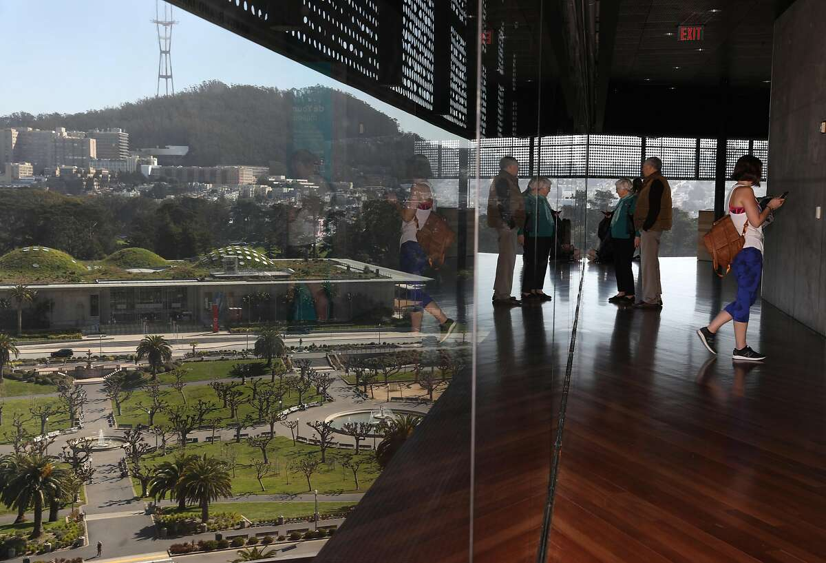 Visitors seen on the observation tower at the De Young museum on Wednesday, Feb. 26, 2020, in San Francisco, Calif.