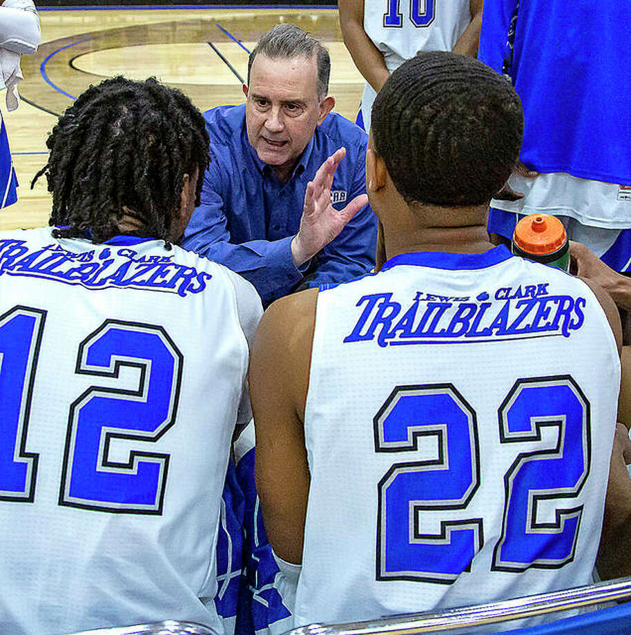 Lewis and Clark Community College men's basketball coach Doug Stotler talks to his team, including Trailblazers Jalen Morgan (12) and Jevon Laidler, during a timeout earlier this season. A former NJCAA Division II national power, LCCC will post its first winning record in Division I this season after 10 years. Photo: Jan Dona | For The Telegraph