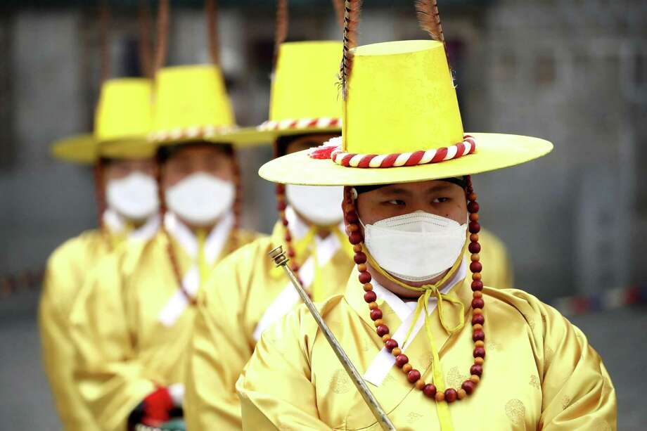 Coronavirus has spread from China to nearby South Korea where the country's palace guards were wearing masks during a re-enactment of the Royal Guards Changing Ceremony in front of Deoksu Palace in Seoul. Photo: Chung Sung-Jun /Getty Images / 2020 Getty Images