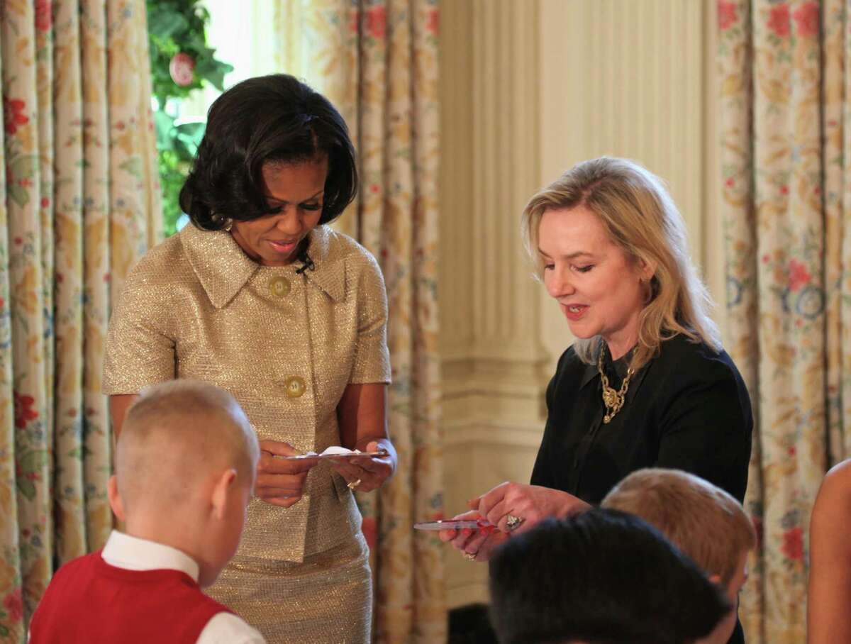 Laura Dowling is shown with former first lady Michelle Obama. Dowling was the official White House florist for six years during the Obama administration.