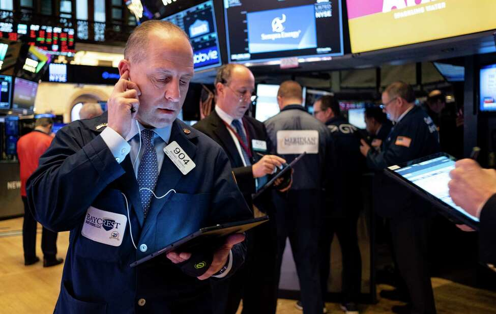 Trader Michael Urkonis works on the floor of the New York Stock Exchange Thursday, Feb. 27, 2020. (AP Photo/Craig Ruttle)