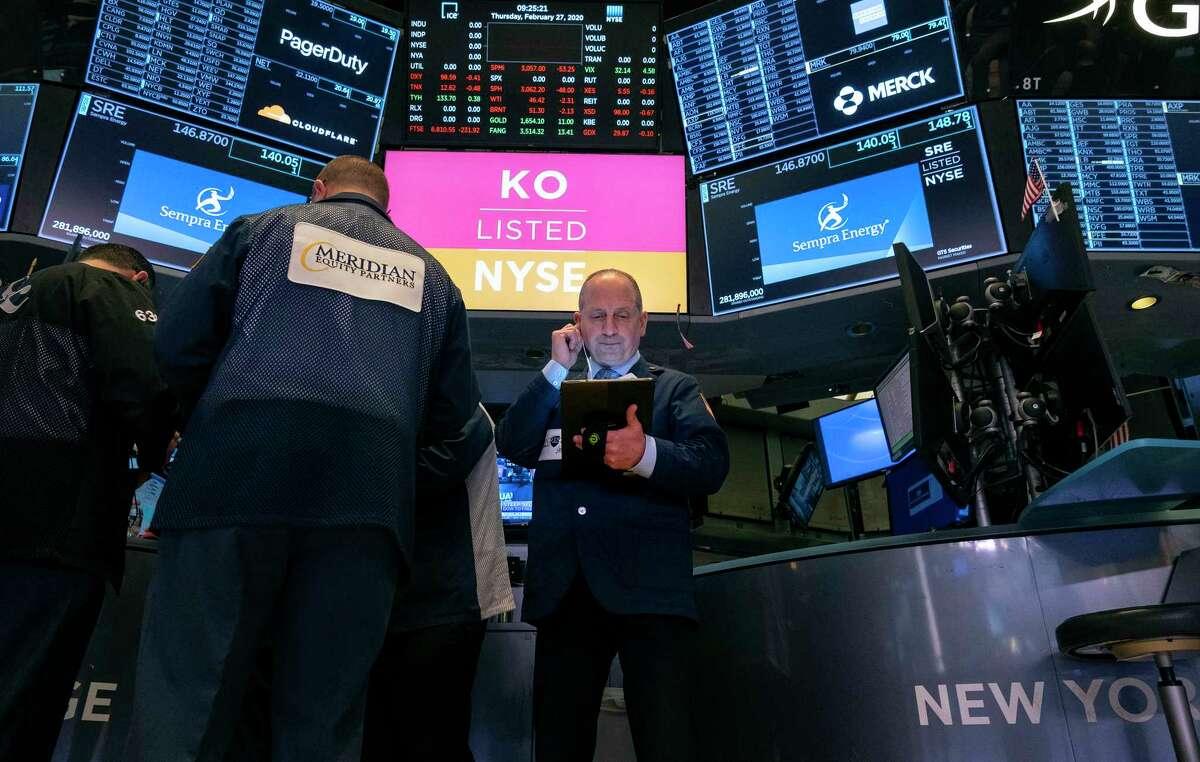 Traders work on the floor of the New York Stock Exchange Thursday, Feb. 27, 2020. (AP Photo/Craig Ruttle)