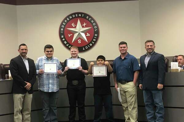 The grand and reserve champions from the Huffman ISD Unified Livestock Show were recognized before the Feb. 24 Huffman ISD Board of Trustees meeting.