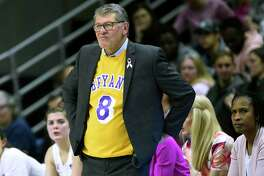 UConn coach Geno Auriemma wears a jersey honoring late NBA star Kobe Bryant during a game in Storrs earlier this month.