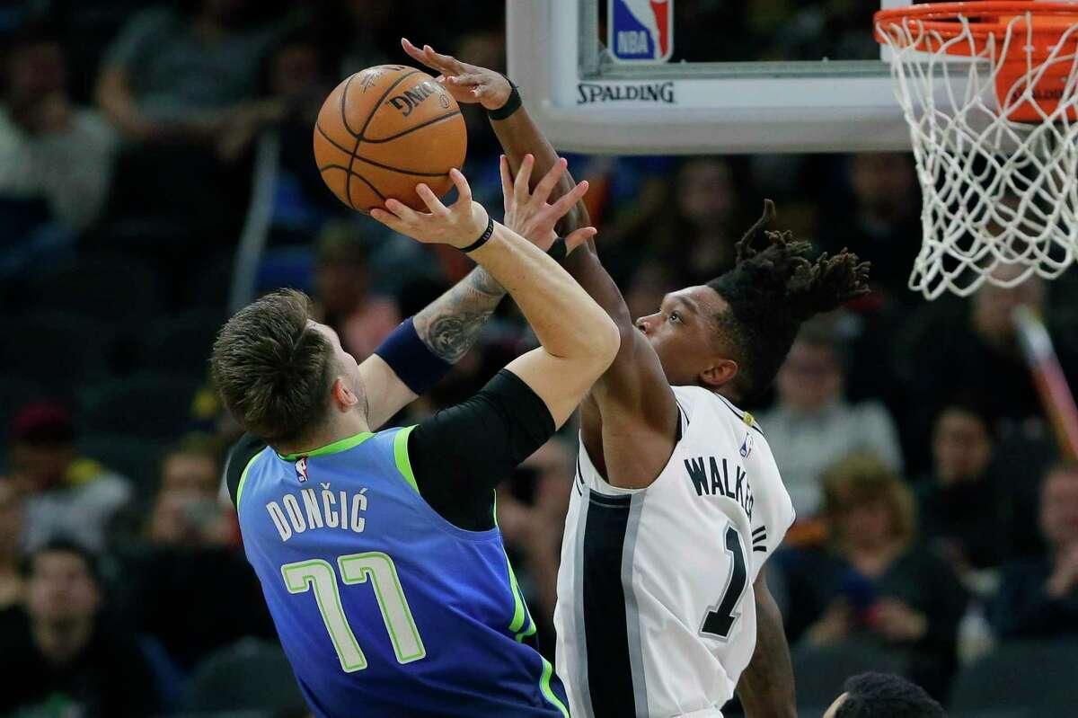 Dallas Mavericks guard Luka Doncic (77) shoots against San Antonio Spurs guard Lonnie Walker IV (1) during the second half of an NBA basketball game in San Antonio, Wednesday, Feb. 26, 2020. (AP Photo/Eric Gay)