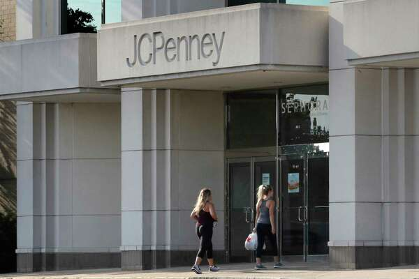 FILE - In this Aug. 14, 2019, file photo two women walk into the JCPenney store in Peabody, Mass. J.C. Penney Co. reports earnings Thursday, Feb. 27. (AP Photo/Charles Krupa, File)