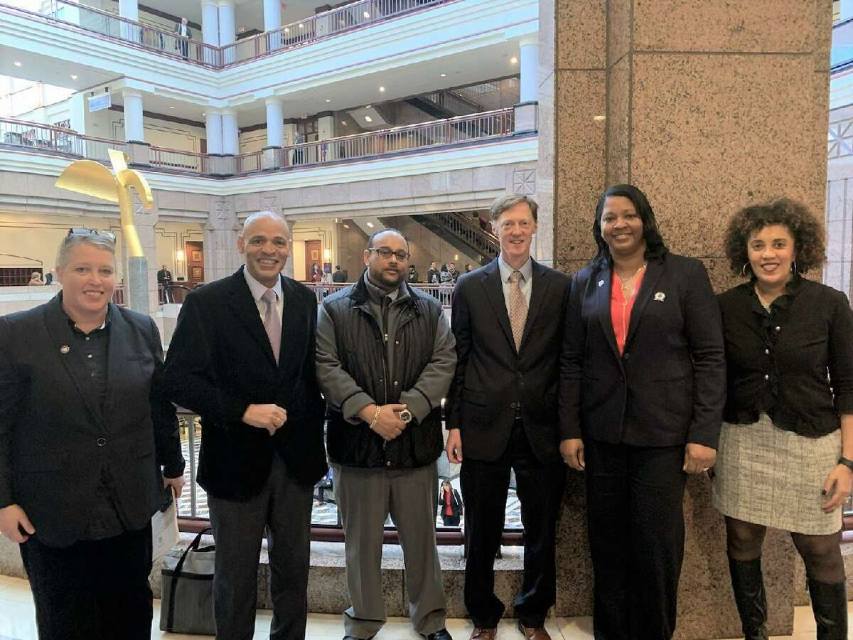 From left, City Plan Director Aicha Woods, New Haven Livable City Initiative Deputy Director Rafael Ramos, LCI Project Manager Jeffrey Moreno, Mayor Justin Elicker, LCI Manager for Neighborhood and Commercial Development Arlevia Samuel and Housing Authority Executive Director Karen DuBois Walton.