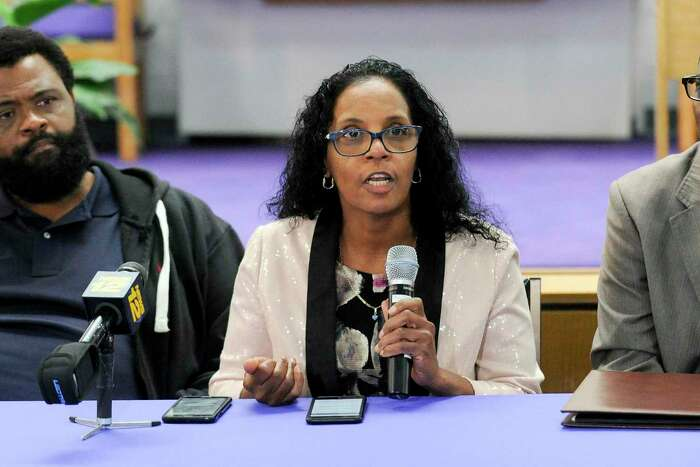 Steven Barrier Sr., at left, and Rev. Robert Jackson, at right, listen as Valerie Jaddo, mother of Steven Barrier, reads a prepared statement during a press conference at Bethel AME Church in Stamford on Oct. 25, 2019, regarding the incident with her son and the Stamford Police Department. Clergy, community leaders and the Stamford NAACP along with family members release of information into what happen.