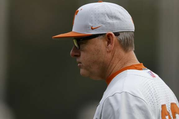 Texas's head coach David Pierce (22) looks on during an University of Texas at Rice University NCAA college baseball game, Saturday, Feb. 15, 2020, in Houston. (AP Photo/Aaron M. Sprecher)