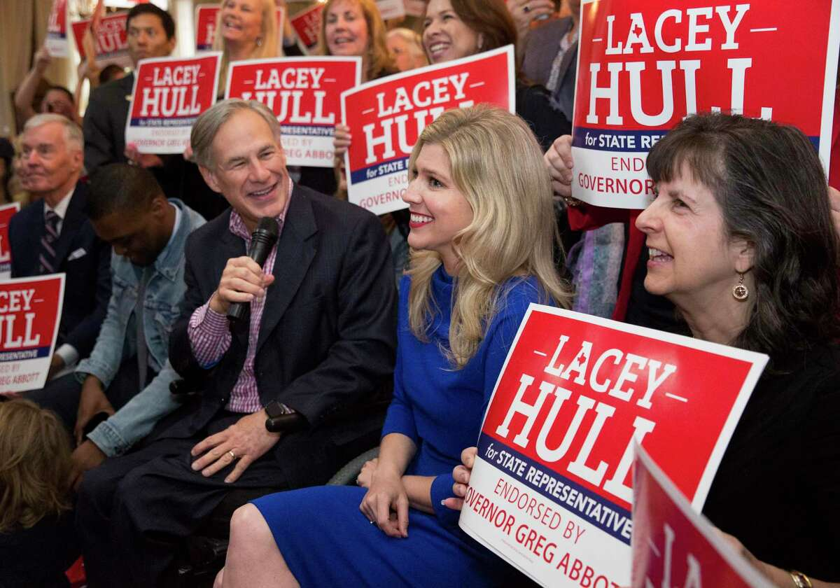 Texas Gov. Greg Abbott records a video with Lacey Hull, right, candidate for State Representative in House District 138, and her supporters during a campaign event Monday, Feb. 24, 2020, at Fratelli's Ristorante in Houston. The governor endorsed Hull on February 11, 2020.