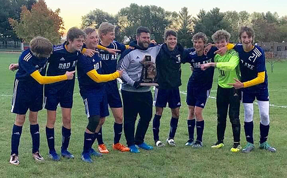 Matt Varner poses with the 2019 Bad Axe boys soccer team in this file photo. Varner, who served as an assistant coach with the boys and girls teams for several seasons, will take over as girls head coach for the 2020 season.