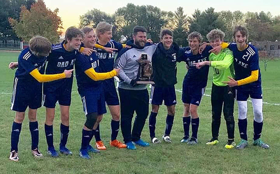 Matt Varner poses with the 2019 Bad Axe boys soccer team in this file photo. Varner, who served as an assistant coach with the boys and girls teams for several seasons, will take over as girls head coach for the 2020 season. Photo: Submitted Photo