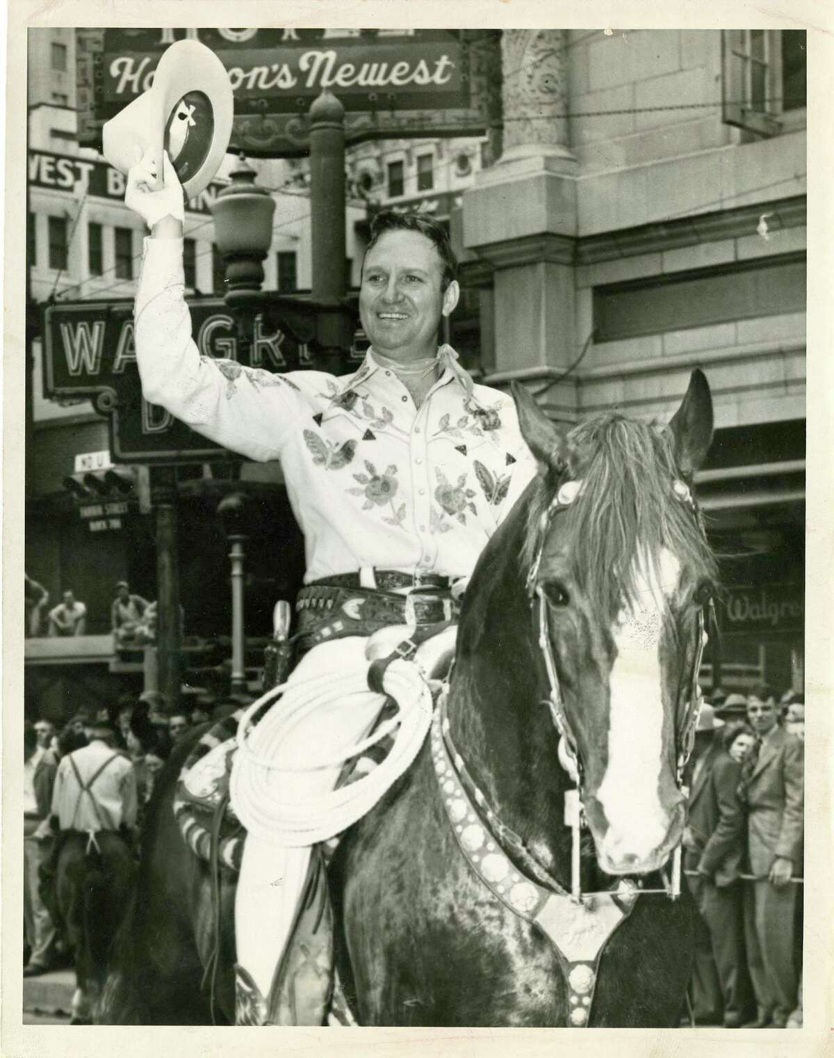 Gene Autry - 1996 Gene Autry with his magnificent horse, Champion, rode into the Houston Rodeo arena and into the hearts of Houstonians when he appeared as the Show's first big name star entertainer in 1942.This larger than life cowboy hero set a high standard for future Houston Rodeo entertainers. He also worked behind the scenes, producing the Houston Rodeo for many of its early years. Entertainer Gene Autry in Houston Fat Stock Show and Rodeo parade , Jan. 31, 1947.