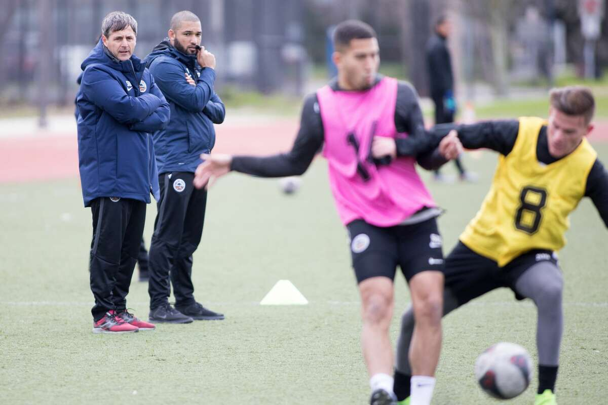 (Left to right) Oakland Roots assistant head coach Dario Pot and head coach Jordan Ferrell gives some instruction during a team practice at the College of Alameda on Jan/ 21, 2020.