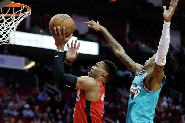 Russell Westbrook glides past Rookie of the Year favorite Ja Morant for a layup in the Rockets' 140-112 rout of the Grizzlies on Wednesday night at Toyota Center.