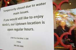 A sign on the door of Ninfa's in Houston following the water main break on Thursday, Feb. 27, 2020.