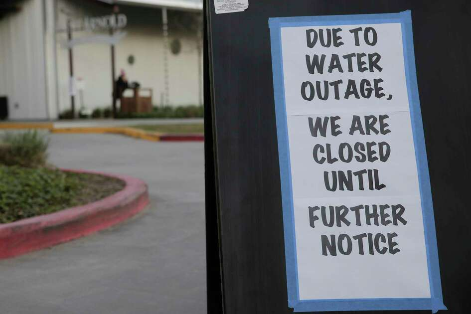 A sign on the outside the parking lot of St. Arnold's Brewery in Houston following the city's water main break on Thursday, Feb. 27, 2020.