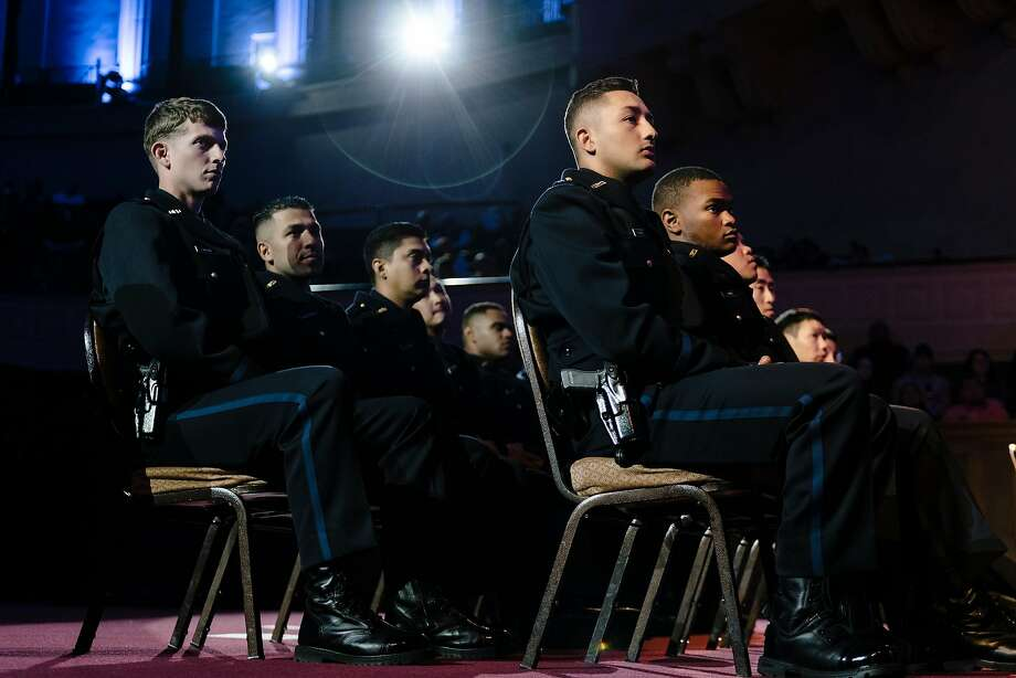 Newly sworn-in Oakland police officers listen during the academy graduation this month. Photo: Michael Short / Special To The Chronicle