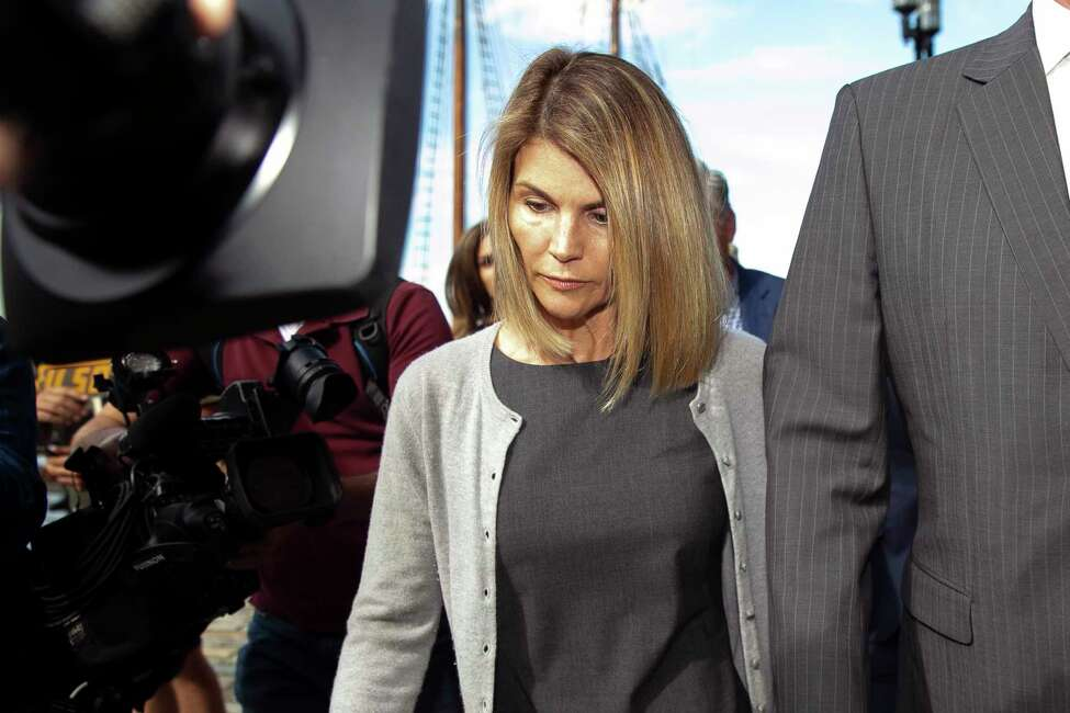 FILE -- Lori Loughlin, the actor, leaves federal court in Boston on Aug. 27, 2019. She is among the 15 parents who have pleaded not guilty in the college admissions bribery scandal and appear headed to trial, possibly this year. (Katherine Taylor/The New York Times)