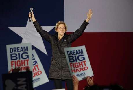 Democratic presidential candidate Sen. Elizabeth Warren acknowledges the crowd as she gets on stage for a town hall meeting at Sunset Station, Thursday, Feb. 27, 2020. Former San Antonio Mayor and HUD Secretary Julian Castro introduced Warren at the event.