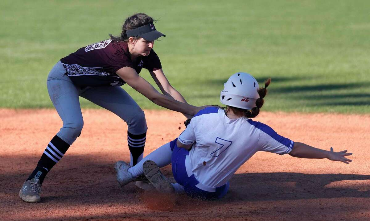 Magnolia shortstop Gabrielle Huetter (13) tags out Morgan Brandon #7 of Oak Ridge during the third inning of a non-district high school softball game at Oak Ridge High School, Thursday, Feb. 27, 2020, in Oak Ridge.