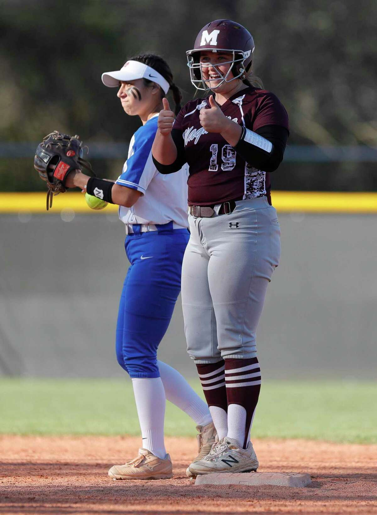 Caitlyn Stevens #19 of Magnolia gives a thumbs-up after hitting an double during the fourth inning of a non-district high school softball game at Oak Ridge High School, Thursday, Feb. 27, 2020, in Oak Ridge.