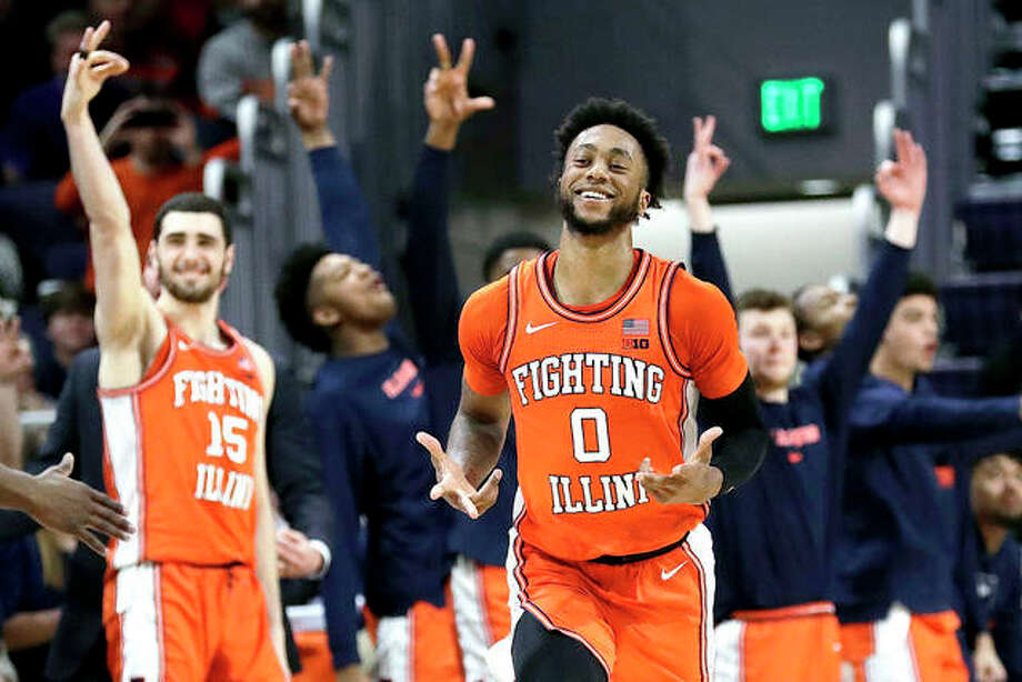 Illinois guard Alan Griffin reacts after making a 3-point basket in the second half of Thursday night's game against Northwestern in Evanston. Illinois won 74-66. Photo: AP Photo