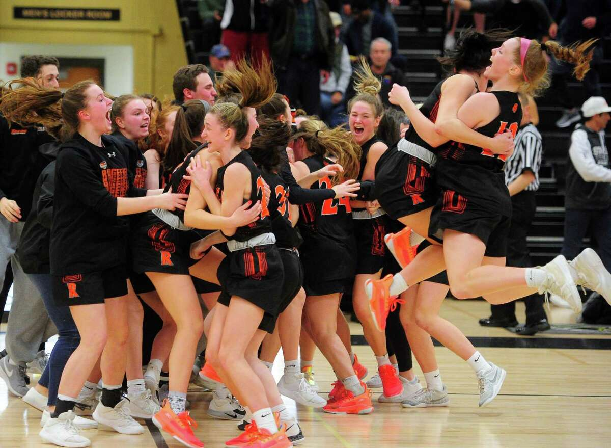 Ridgefield celebrates its win over Staples in FCIAC Girls' Basketball Championship action in Trumbull, Conn., on Thursday Feb. 27, 2020.