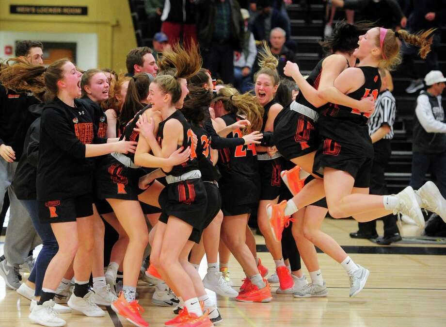Ridgefield celebrates its win over Staples in FCIAC Girls' Basketball Championship action in Trumbull, Conn., on Thursday Feb. 27, 2020. Photo: Christian Abraham / Hearst Connecticut Media / Connecticut Post