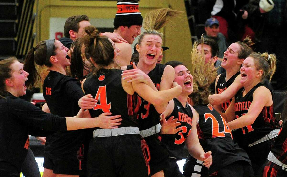 Ridgefield celebrates after beating Staples to win the FCIAC girls basketball championship on Feb. 27, 2020.