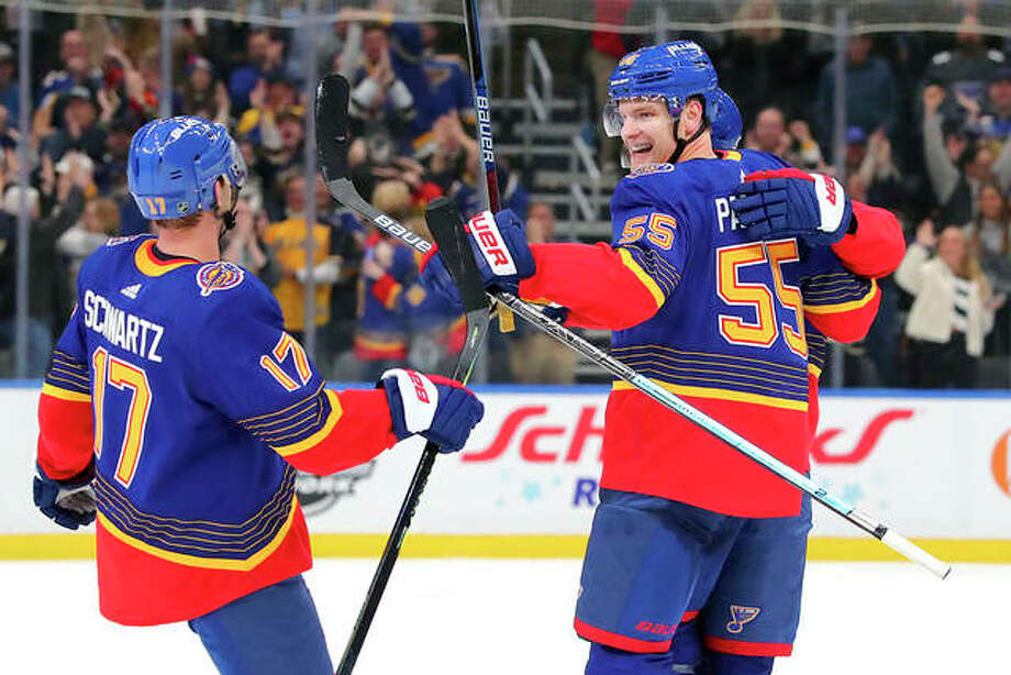 Blues defenseman Colton Parayko (55) celebrates with after scoring the winning goal against the New York Islanders in overtime Thursday night in St. Louis. Photo: AP Photo